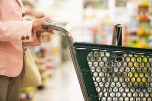 Woman Pushing Shopping Cart